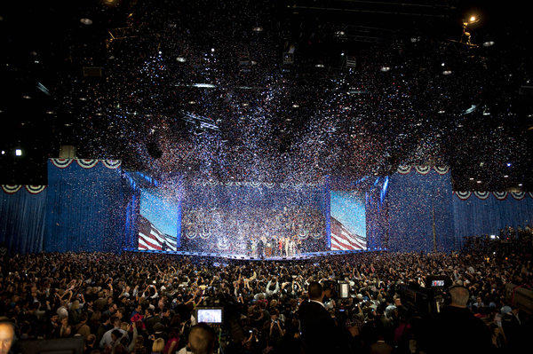 Confetti fills the air during an election night rally in Chicago, Illinois.