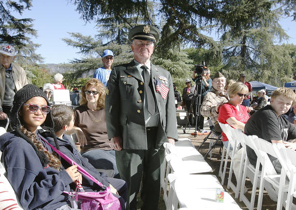 "Ray Ackerman, of Burbank, who served in the Army in 1951, stands as the military anthem for the Army, ""The Army Song"" is played and sung at the Veterans Day Ceremony at McCambridge Park War Memorial in Burbank on Monday November 12, 2012."
