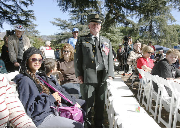 "Ray Ackerman, of Burbank, who served in the Army in 1951, stands as the military anthem for the Army, ""The Army Song"" is played and sung at the Veterans Day Ceremony at McCambridge Park War Memorial in Burbank on Monday November 12, 2012. The event was sponsored by the City of Burbank and the Burbank Veterans Committee."