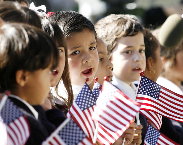 Kindergartners from St. Robert Bellarmine Catholic Elementary School sing the National Anthem at the Veterans Day Ceremony at McCambridge Park War Memorial in Burbank on Monday November 12, 2012. The event was sponsored by the City of Burbank and the Burbank Veterans Committee.