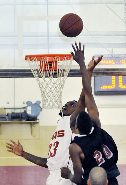 GCC's Mike Johnson drives inside for a shot attempt against Compton's Luis Engleton in the second half in a non-conference men's basketball game at GCC on Friday, November 9, 2012.