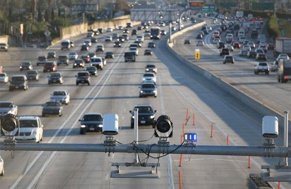 Cameras and electronic sensors stand over the toll lane south of Slauson Avenue on the 110.