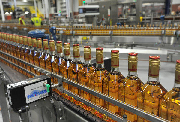 Bottles of Jose Cuervo tequila move along a conveyor belt in the bottling hall. Diageo officials held an official reopening ceremony and tour today at their Relay plant, where they have invested more than $50 million to upgrade the facility where they blend, bottle and pack premium liquor brands, including Captain Morgan, Jose Cuervo and Seagrams.