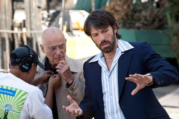 "Ben Affleck, right, directs Alan Arkin on the set of ""Argo."""