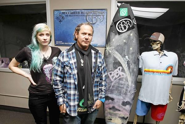Buccanner Board Riders' President and CEO, Matt Stone, right, and creative director Mariah Kenyon, have collected several boxes of basic needs for the upper East Coast victims of Hurricane Sandy on behalf of Project Save Our Surf.