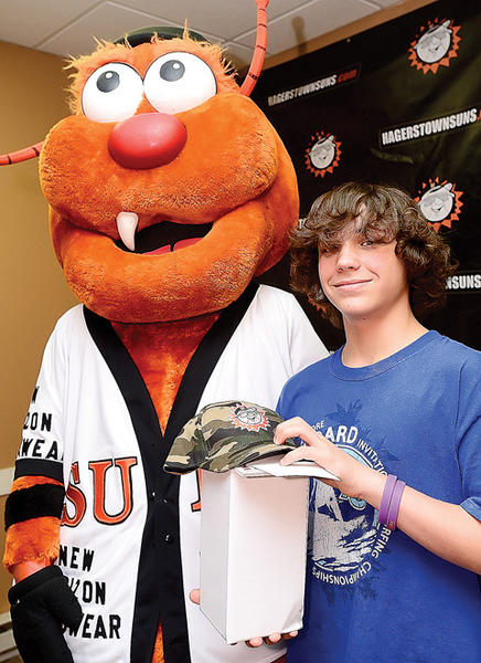 "Marcus Manners, right, 13, of Hagerstown, took first place in the ""biggest and woolliest"" division of this year's Woolly Bear Caterpillar Contest. Standing with Marcus is Woolie B, the Hagerstown Suns mascot."
