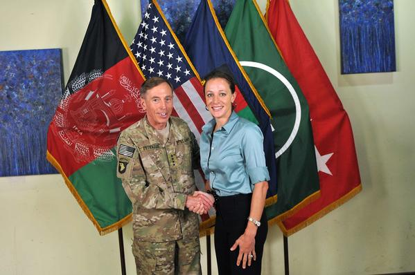 "CIA Director Gen. Davis Petraeus shakes hands with biographer Paula Broadwell, co-author of ""All In: The Education of General David Petraeus"" on July 13, 2011. Petraeus resigned from his post on Nov. 9 citing an extra-marital affair with Broadwell."
