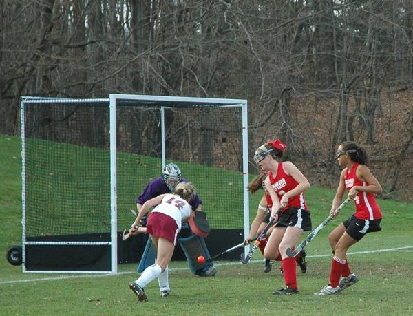 Farmington's Haley Campbell shoots on goal, but Branford goalkeeper Jessie Severino makes the save in the first half of the Class M field hockey quarterfinals at Farmington Monday. Farmington won 1-0 on a first-half goal by Jamie Bartucca.