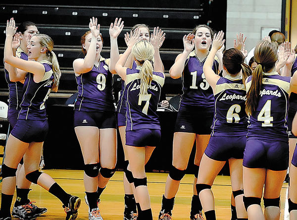 Members of the Smithsburg volleyball team celebrate their Maryland Class 1A state semifinal sweep of Sparrows Point at the University of Maryland at College Park on Monday.