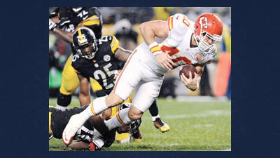 Kansas City Chiefs running back Peyton Hillis (40) rushes the ball past Pittsburgh Steelers free safety Ryan Clark (25) and cornerback Keenan Lewis, bottom, in the second quarter of an NFL football game Monday in Pittsburgh.
