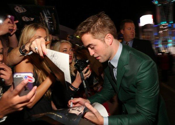 "Robert Pattinson works the fan line on his way into the Nokia Theatre for the premiere of the final ""Twilight"" movie, ""Breaking Dawn -- Part 2."""