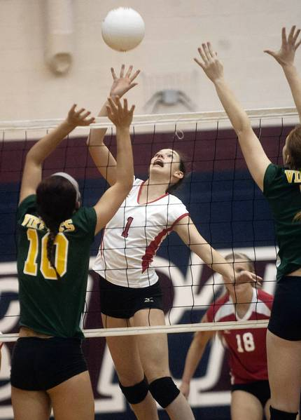 Parkland's Brooke Robertson hits at the net in a match against Central Catholic earlier this season.