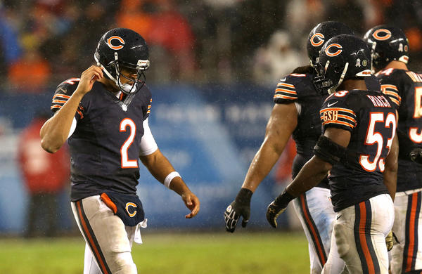 Bears quarterback Jason Campbell  walks off the field after failing to get a first down on the final offensive attempt of the game against the Houston Texans at Soldier Field.