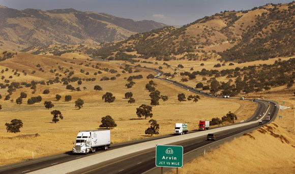 Vehicles travel westbound on California 58 near White Wolf fault in Kern County after descending through the Tehachapi Pass crossing the Tehachapi Mountains.