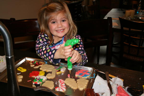 Ally Goelz of Petoskey learns the basics of cookie decorating.