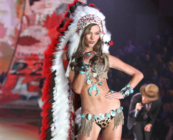 Karlie Kloss modeled the controversial leopard-print outfit with a Native American headdress.