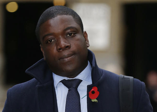 Former UBS trader Kweku Adoboli arrives at Southwark Crown Court in London. Adoboli was arrested at UBS's London offices in September last year. He denies four counts of false accounting and two of fraud by abuse of position