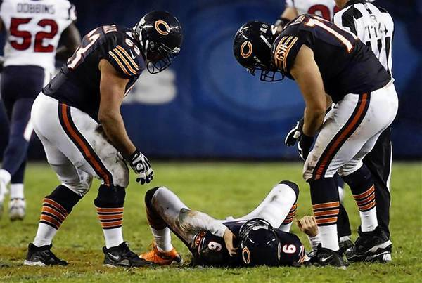 Chicago Bears quarterback Jay Cutler lies on the field after being hit late on a play by the Houston Texansl. Cutler didn't play in the second half.