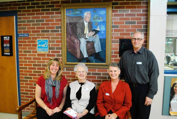 Clifford Johnson's widow, Fay, second from left, and daughter Debra Swinden, third from left, sit on the bench dedicated to Clifford last week at the elementary school. Also pictured are Johnson's daughter-in-law and son-in-law.