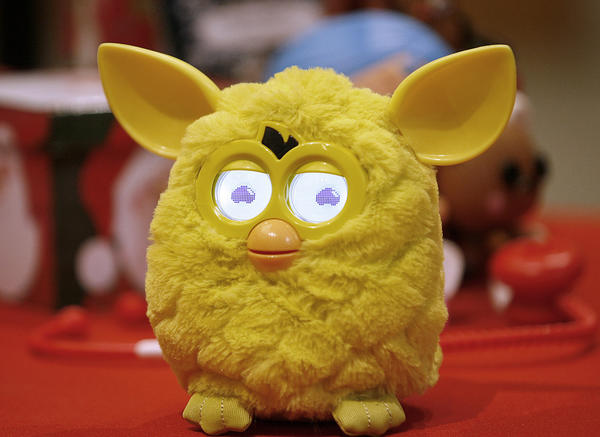 "The new Furby toy from the Toys R Us pop up store at the Glendale Galleria was highlighted during holiday press conference at the Glendale indoor mall on Tuesday, Nov. 13, 2012.  Furby, at a cost of $54, comes in six colors, can interact with other Furbys and according to a press release, is ""emotional and unpredictable."""
