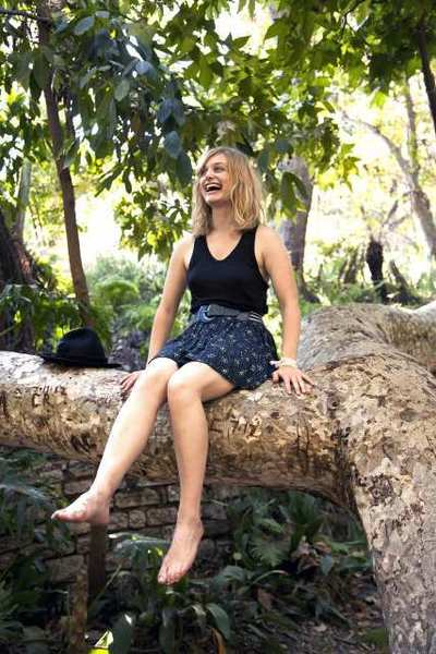 "Alison Sudol, of the band A Fine Frenzy, sits in a tree in Griffith Park. Her new album, ""Pines,"" connects nature and human emotion. Sudol spent her adolescent years in Burbank and recorded her first album there, and performs Nov. 16 at the Wiltern Theater."