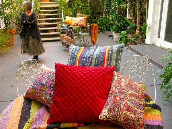 Pat McGann will have pillows, blankets and the chairs pictured here at the courtyard sale with Harbinger and Hollywood at Home.
