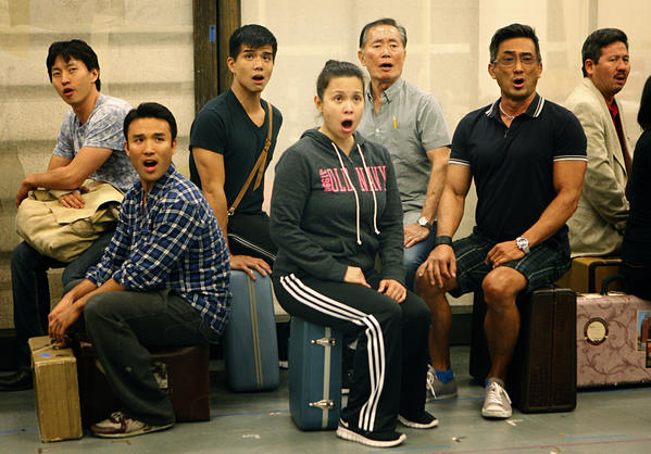 "The ensemble of ""Allegiance"" rehearses at the Old Globe Theater rehearsal hall in San Diego on Aug. 23, 2012. Together in the middle are the three lead actors, left to right, Telly Leung, Lea Salonga and George Takei, who star in the musical about Japanese Americans in a World War II detention center.<br> <a href=""http://articles.latimes.com/2012/sep/16/entertainment/la-et-cm-allegiance-old-globe-20120916"" target=""blank""><b>MORE:</b> George Takei builds on legacy with 'Allegiance' at the Old Globe</a>"
