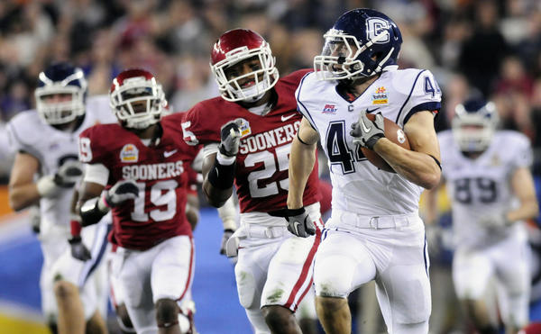 UConn played in the Fiesta Bowl in after the 2010 season. Oklahoma crushed the Huskies in UConn's only BCS appearance. (Courant file photo)