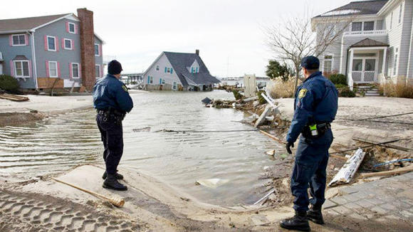 Michigan State Police Trooper Jim Gillespie and Sgt. Richard Dragomer on foot patrol in Mantoloking, New Jersey, in the wake of Hurricane Sandy.