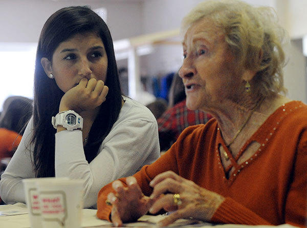 Palm Beach Central High School student Jaclyn Senft listens to Holocaust survivor Frieda Solnick, 90, of Sunrise, tell of surviving and escaping from German work camps during a presentation Tuesday to about 250 high school students.