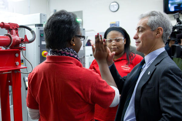 Mayor Rahm Emanuel speaks with seniors Desiree Wordlaw, left, and Jennifer Curtis, center, at Austin Polytechnical High School.
