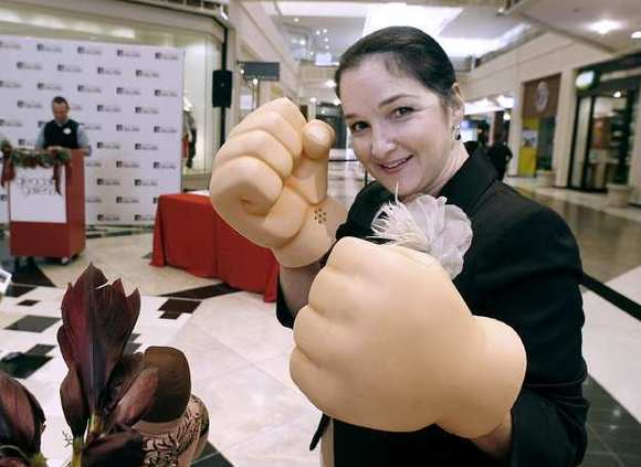 Shoshana Puccia strikes a pose with a pair of Wreck-It Ralph Smash Hands from the Disney Store during holiday press conference at the Glendale indoor mall on Tuesday, Nov. 13, 2012.