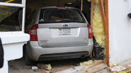 PICTURES: Vehicle crash through Bird Mania on Emmaus Ave.