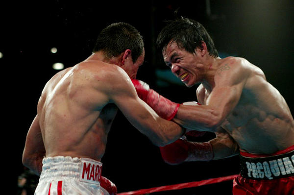 Manny Pacquiao, right, and Juan Manuel Marquez exchange punches during their first fight.