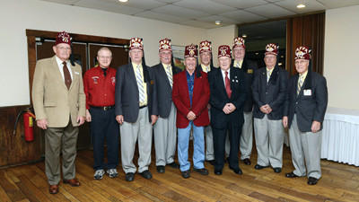 Staff photo by Roger Vogel Shriners officers at a recent dinner at Oakhusrt Tea Room Inc. in Somerset are President of Somerset County Shrine Club William Hoffman, David Krentz, Miles K. Costello, Vernon Carey, Stan Landis, John Campbell, Tom Brown, Foster Snively, Jerry Grahm and Leon Collins.