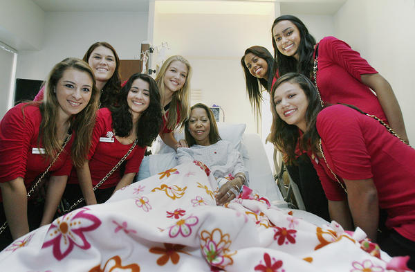 The 2013 Rose Court with patient Dana Thompson, of Glendale, at Glendale Adventist Medical Center in Glendale for the resumed annual visit by the Rose Court to visit staff and patients on Tuesday, November 13, 2012.