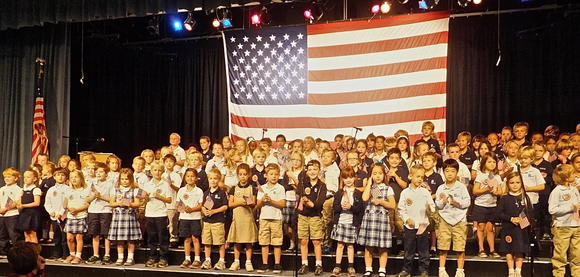 Mariners Christian School students recite patriotic passages and sing patriotic songs at the Veterans Day event on Friday.