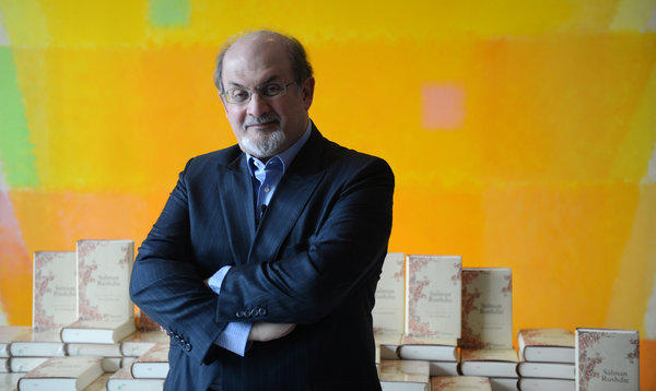"Rushdie poses in front of copies of his book ""Joseph Anton"" on Oct. 1, 2012 in Berlin."