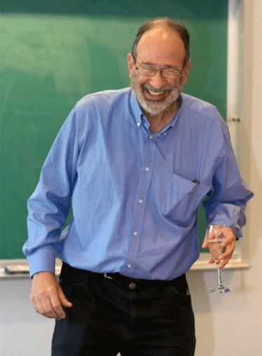 Alvin Roth, a Harvard Business School professor who is currently a visiting professor at Stanford University, reacts during an economics class after receiving a toast from students for being awarded a Nobel Memorial Prize in Economic Sciences.