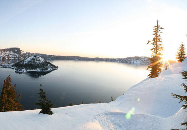 Snowmobiling At Crater Lake National park in Oregon is part of an EverGreen Escapes package.