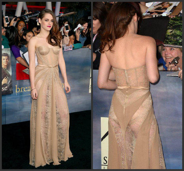 "Kristen Stewart poses on the red carpet and greets fans in an oh-so-sheer gown at the ""Twilight Saga: Breaking Dawn -- Part 2"" premiere."