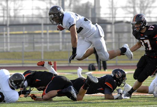 Joliet Catholic's Ty Isaac carries the ball against Lincoln-Way West.