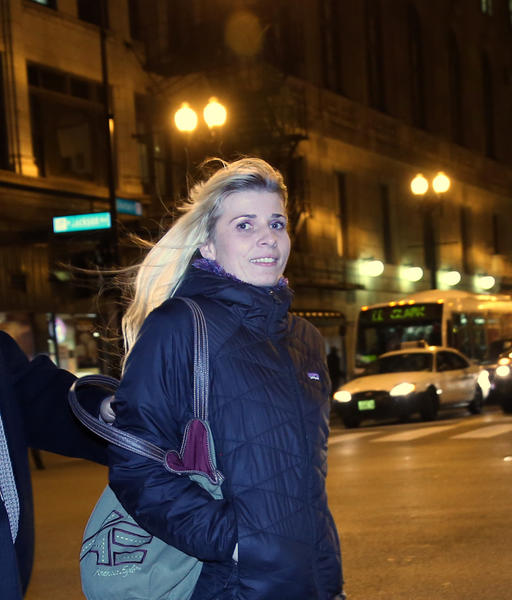 Karolina Obrycka exits the Dirksen U.S. Courthouse with attorney Gustavo Munoz after a jury awarded her $850,000 in compensatory damages as a result of a 2007 beating she took from former Chicago police officer Anthony Abbate.