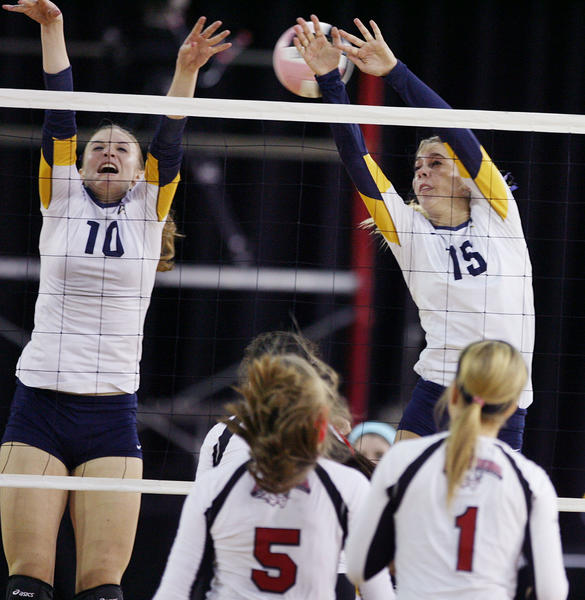 Boca players Katie LaPorte (10) and Charlotte Earnhart (15) leap as they attempt to block a shot over Lake Mary players Katie Haak (5) and Amber Jones (1) during the Lake Mary versus Boca Raton Class 8A FHSAA Girls High School Volleyball State semifinal game at the Silver Spurs Arena in Kissimmee on Tuesday, November 13, 2012.