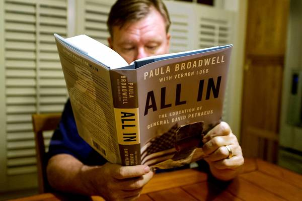 "A man reads biographer Paula Broadwell's book ""All In: The Education of General David Petraeus,"" in Manassas, Virginia, on November 13, 2012. Petraeus' surprise resignation as CIA director on Friday resulting from an extramarital affair has now spiraled into a complicated story of infidelity, intrigue and politics."