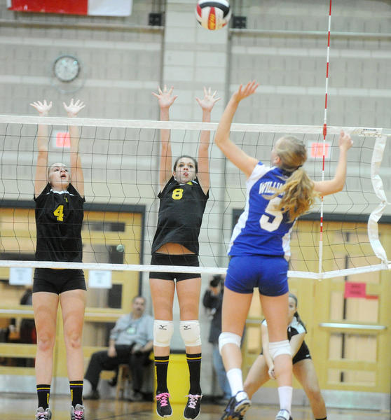 Loch Raven's Katie Costello, left, and teammate Maggie Williams attempt to block Williamsport's Courtney Malott during the Wildcats' sweep in the Class 2A state semifinals.