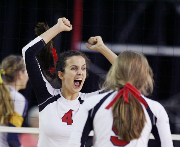 Lake Mary players including Maggie Pinnock (4) celebrate after a point during the Lake Mary versus Boca Raton Class 8A FHSAA Girls High School Volleyball State semifinal game at the Silver Spurs Arena in Kissimmee on Tuesday, November 13, 2012.