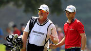 Kissimmee's Damon Green, the longtime caddie for former Masters champion Zach Johnson, shares the lead with PGA Tour veteran Bobby Clampett after one round of the Champions Tour qualifying final in Coral Springs.