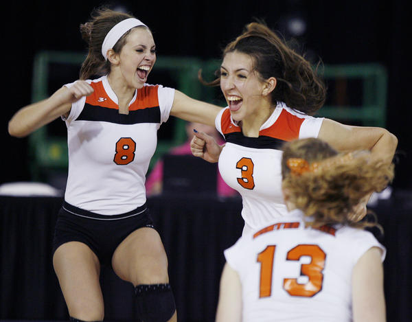 Winter Park players celebrate after winning the Winter Park versus Miami Coral Reef Class 8A FHSAA Girls High School Volleyball State semifinal game at the Silver Spurs Arena in Kissimmee on Tuesday, November 13, 2012.