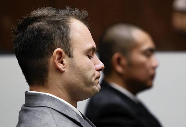 Former LAPD Officer Evan Samuel, left, reacts after the jury found him and Officer Richard Amio, right, guilty of perjury and conspiracy to obstruct justice.